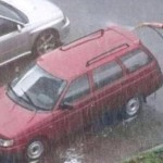 Washing Car in the Rain